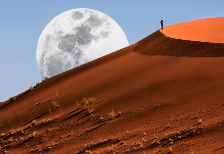 Dune walking in the Namib Desert at Sossusvlei in Namibia